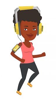 Kobieta działa ze słuchawkami i smartphone.