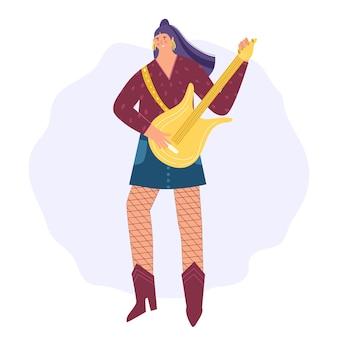 Kobieta gitarzysta. młoda kobieta gra na gitarze elektronicznej.