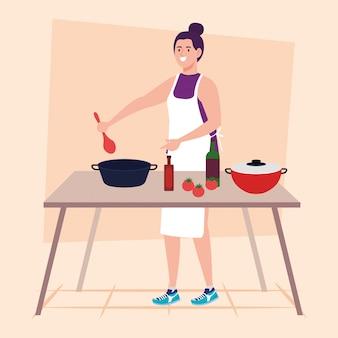 Kobieta gotowanie z drewnianym stołem i garnki, butelki i warzywa