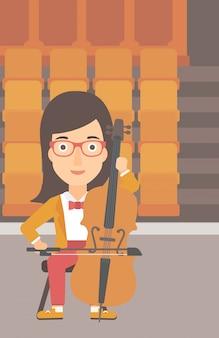 Kobieta gra na wiolonczeli.