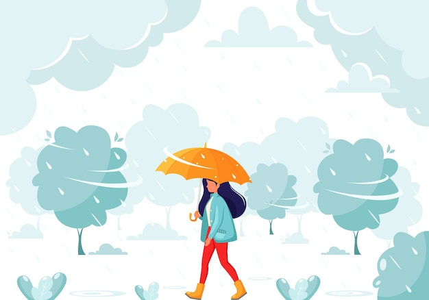 Kobieta idzie pod parasolem podczas deszczu. jesienny deszcz. jesienne zajęcia na świeżym powietrzu.