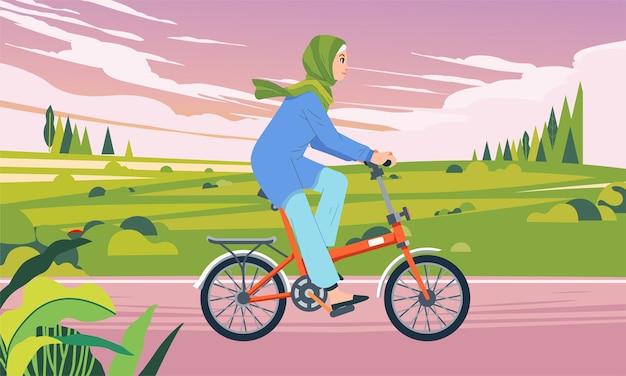Kobieta jadąca na rowerze w dolinie po południu, gdy niebo było zachmurzone ilustracja