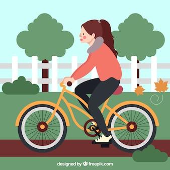 Kobieta jazda na rowerze z płaskim wzorem