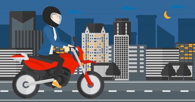 Kobieta jedzie motocykl.