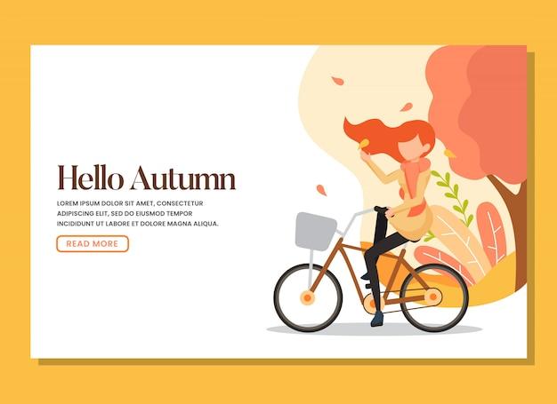 Kobieta jedzie na rowerze na stronie docelowej ciepłego jesiennego dnia