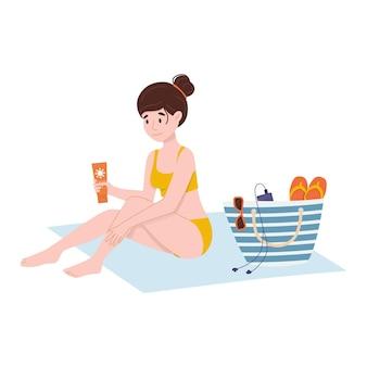 Kobieta jest posmarowana kremem przeciwsłonecznym selfcare