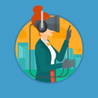 Kobieta jest ubranym słuchawki wirtualnej rzeczywistości.