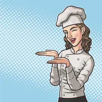 Kobieta kucharz coś pokazuje