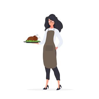 Kobieta kucharz trzyma w ręku pieczonego indyka. dziewczyna w fartuchu trzyma smażonego kurczaka. odosobniony. wektor.