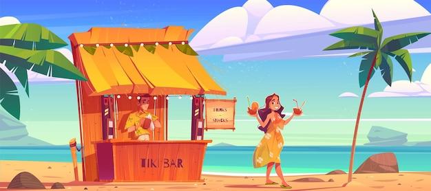 Kobieta kupuje koktajl w barze tiki hut z barmanem na hawajskiej plaży