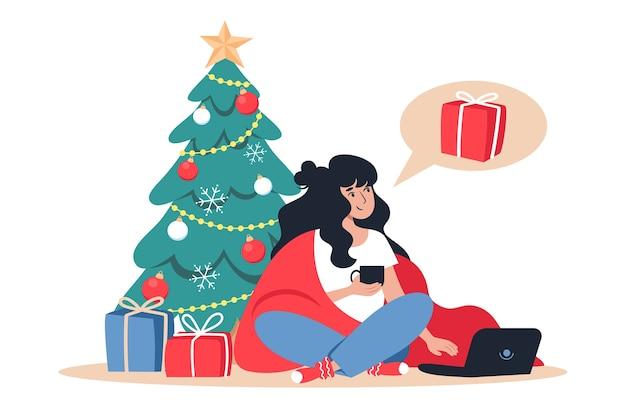 Kobieta kupuje prezenty świąteczne w sklepie internetowym, noworoczne zakupy online z domu