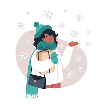 Kobieta łapie płatki śniegu ręką