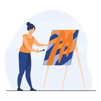 Kobieta maluje obraz artystki. kobieta z pędzlem, sztalugą, dziełami sztuki w studio. ilustracja kreskówka