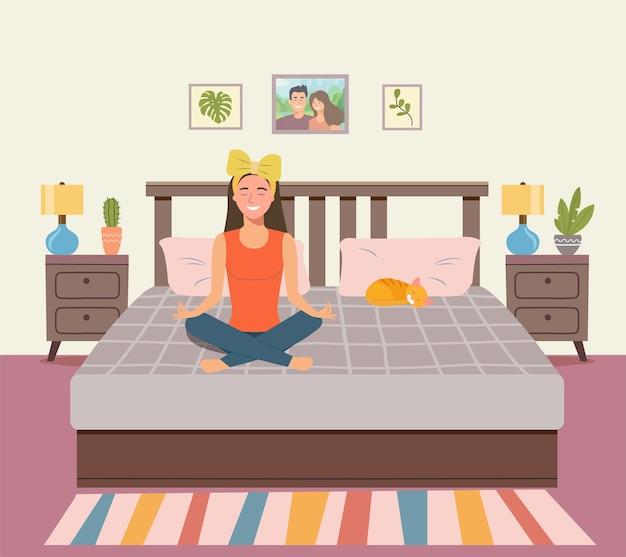 Kobieta medytuje w sypialni. kobieta w pozycji lotosu.
