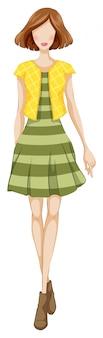 Kobieta moda z zieloną sukienkę i żółtą kurtkę