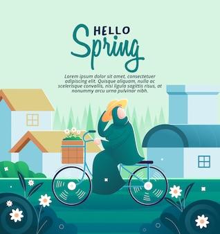 Kobieta na rowerze w pięknym wiosennym ogrodzie
