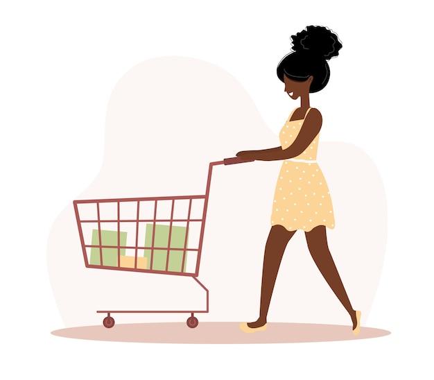 Kobieta na zakupy. szczęśliwa afrykańska dziewczyna z wózkiem i torbami.