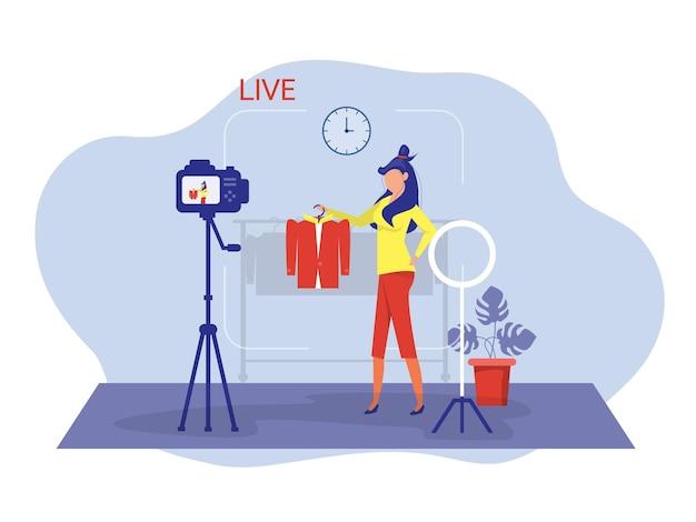 Kobieta nagrywa wideo dla swoich obserwujących i sprzedaje sklep z ubraniami vector