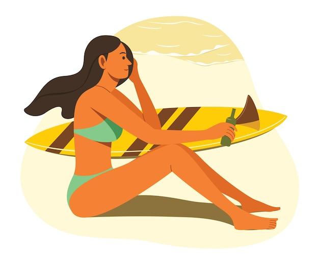 Kobieta nosi bikini i siedzi na plaży z pobliską deską surfingową