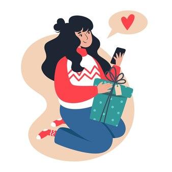 Kobieta otrzymuje i wręcza prezenty, noworoczne i świąteczne zakupy online z domu