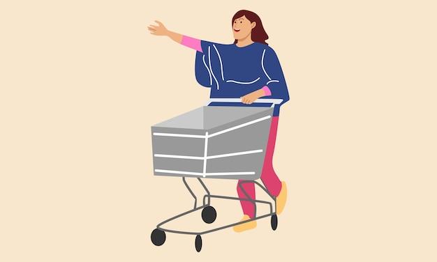 Kobieta pcha koszyk w supermarkecie