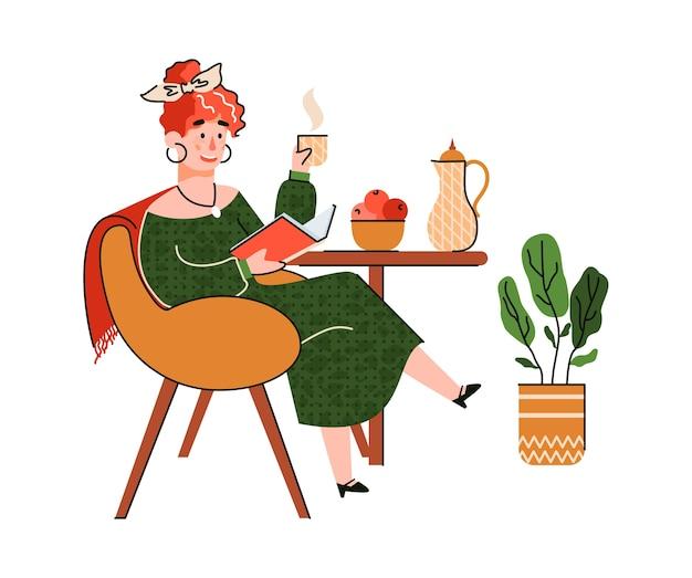 Kobieta pije kawę i czyta książkę