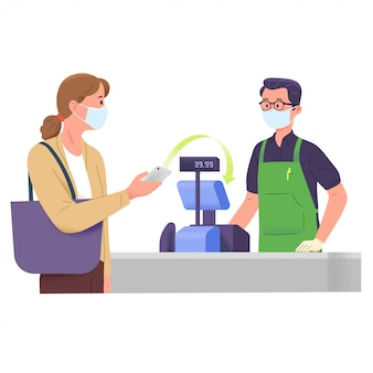 Kobieta płaci sklepowi spożywczemu kasjerowi za pomocą bezgotówkowej płatności cyfrowej w przypadku wybuchu korony wirusa