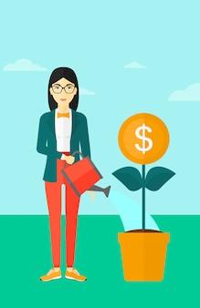 Kobieta podlewania pieniędzy kwiat.