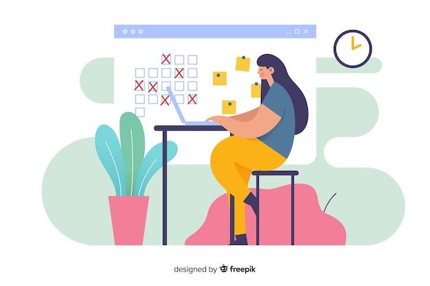 Kobieta przy biurku, patrząc na stronę docelową organizatora kalendarza