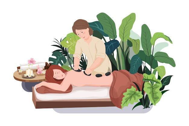 Kobieta robi masaż kobiecie ze skałami