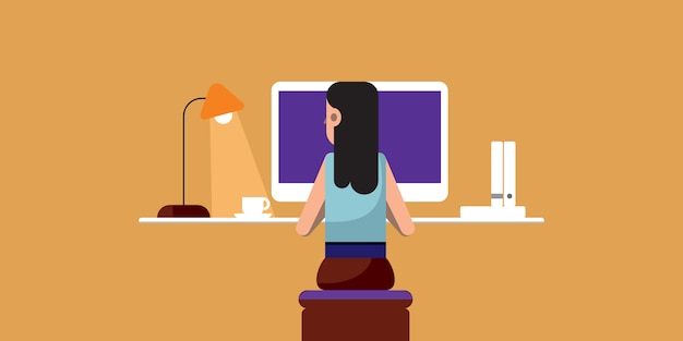 Kobieta robi swoją pracę na komputerze, praca z domu