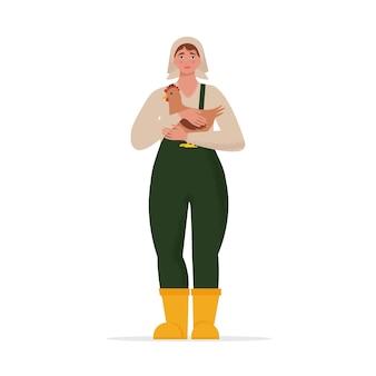 Kobieta rolnik trzymająca kurczaka w ramionach ilustracja w płaskim stylu