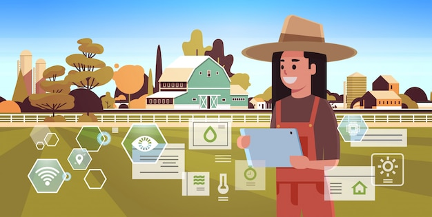 Kobieta rolnik z tabletu monitorowanie warunku kontroluje produkty rolne organizację zbierać mądrze rolniczego pojęcie rolnego budynku krajobrazu tła płaskiego horyzontalnego portret