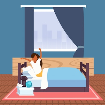 Kobieta rozciąga ramiona budząc się rano afican amerykańska dziewczyna siedzi na łóżku po dobranoc spać nowoczesne mieszkanie wnętrze sypialni