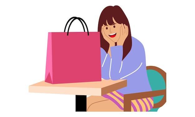 Kobieta siedząca z torbą na zakupy
