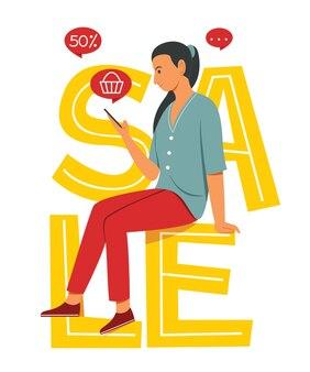 Kobieta siedzi na wielkim słowie i robi zakupy online
