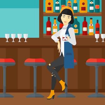 Kobieta siedzi w barze