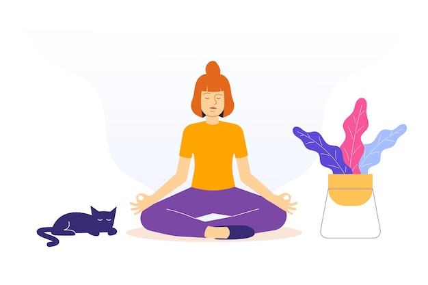 Kobieta siedzi w pozycji lotosu na podłodze
