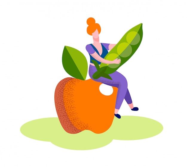 Kobieta siedzieć na ogromny dojrzały jabłczany chwyta zielonego groszku pod