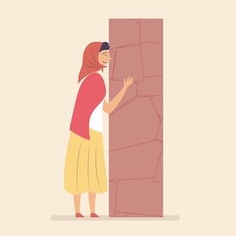 Kobieta skłoniła się modliła się święty kamień