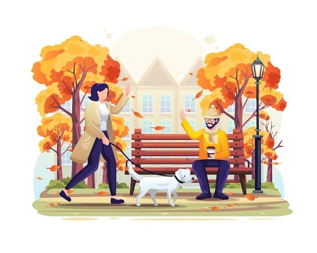 Kobieta spacerująca po parku jesienią z psem i witająca mężczyznę siedzącego na plaży ilustracja