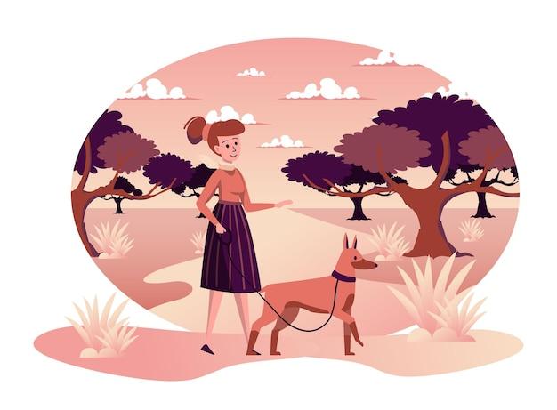 Kobieta spacerująca z psem w jesiennym parku odosobniona scena właścicielka spędza czas ze szczeniakiem
