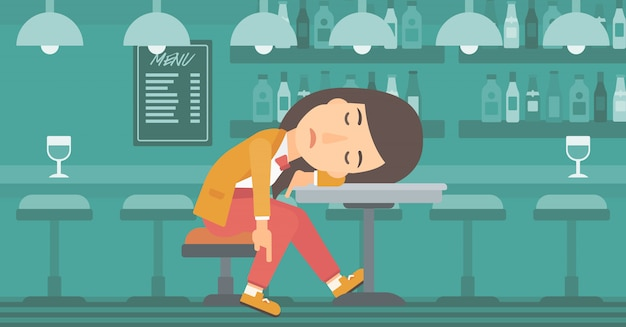 Kobieta śpi w barze.