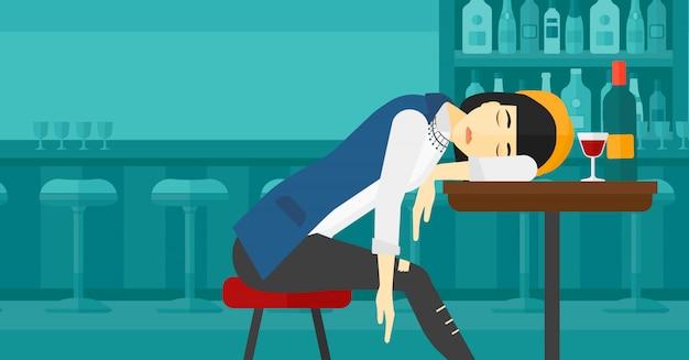 Kobieta śpi w barze