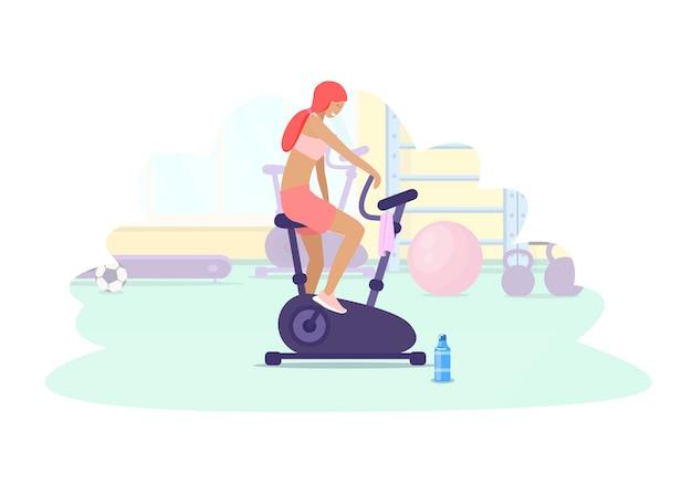 Kobieta treningu w siłowni na rower treningowy. sporty