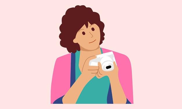 Kobieta trzyma aparat