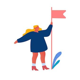 Kobieta trzyma czerwoną flagę w ręku