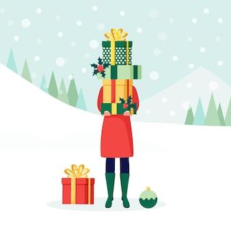 Kobieta trzyma duży stos, stos owiniętych pudełek prezentowych, prezenty ze wstążką w ręku. niespodzianka na wakacje. wesołych świąt, nowy rok, koncepcja wszystkiego najlepszego. wyprzedaż świąteczna