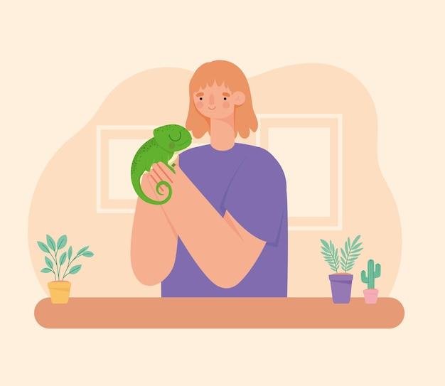 Kobieta trzyma iguana