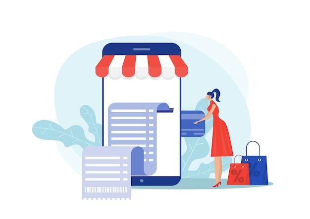Kobieta trzyma kartę kredytową i telefon i dokonuje zakupu online